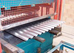 Image showing corrugated profiled sheet as it exits the mill